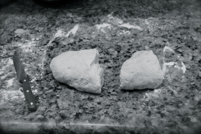 Split dough, one large and one small part.