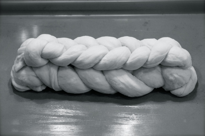 Place the second braid on top and press gently down