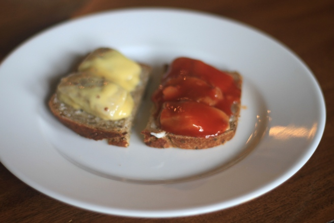 Thin slices of bread with Tomato Herring and Mustard Herring